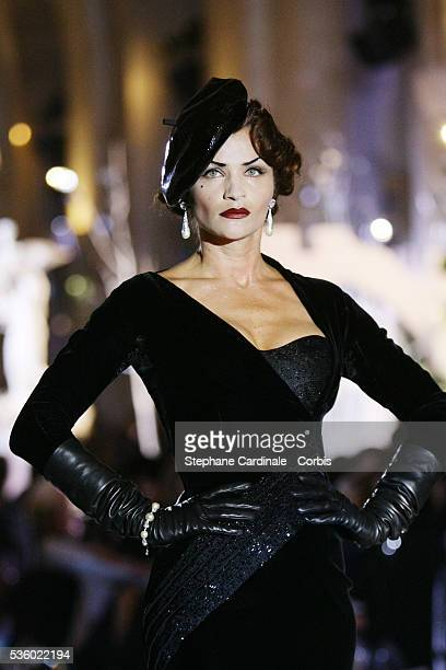 Model Helena Christensen on the catwalk at the Christian Dior Haute Couture FallWinter 2007/2008 collection held at the Versailles Castle Orangery...