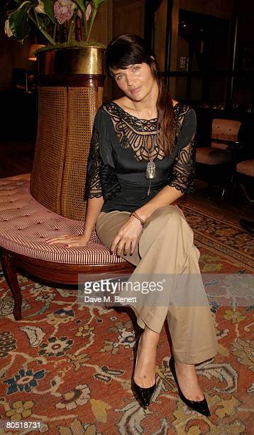 Model Helena Christensen poses with her new codesigned collection of 'Pilgrim' jewellery in aid of Medecins Sans Frontieres at the Covent Garden...