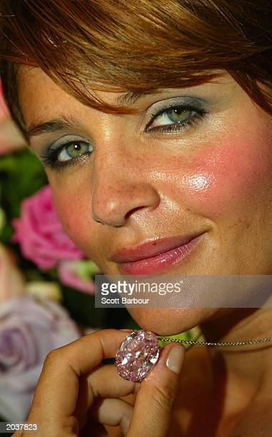 Model Helene Christensen wears the Monaco Rose 5960carat internally flawless pink oval diamond which was unveiled at a press conference at the Monaco...