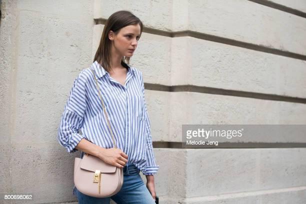 Model Heloise Giraud carries a Chloe bag outside the Balmain show on June 24 2017 in Paris France
