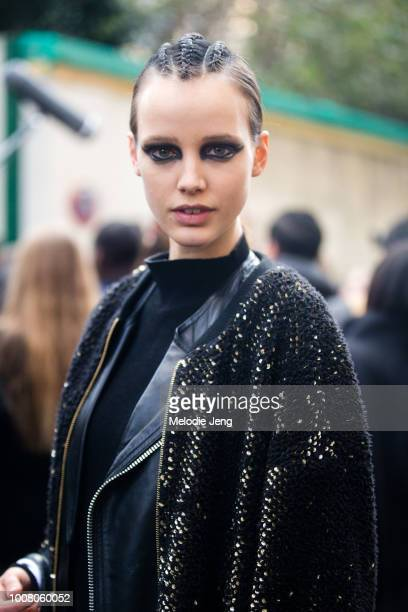 Model Heloise Giraud in black eye makeup and braided hair after the Balmain show at Hotel Potocki during Paris Fashion Week Fall/Winter 2017 on March...