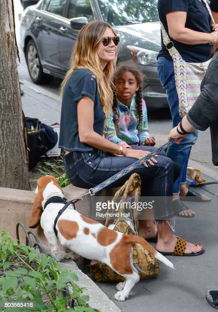 Model Hiedi Klum and Lou Samuel are seen playing with a dog in Soho on June 29, 2017 in New York City.