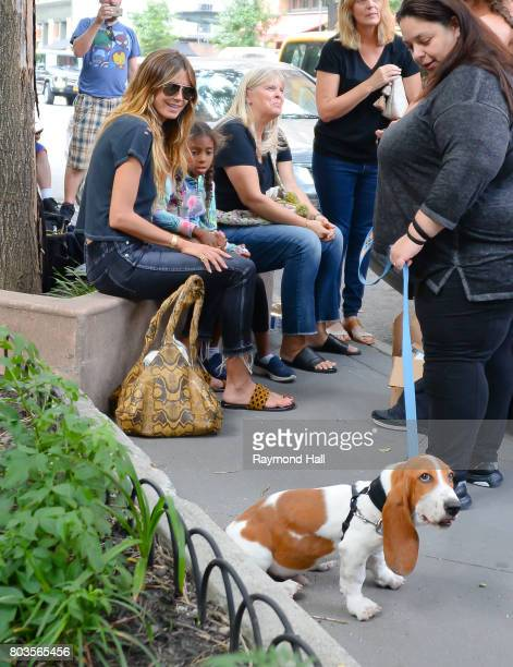 Model Hiedi Klum and Lou Samuel are seen playing with a dog in Soho on June 29 2017 in New York City