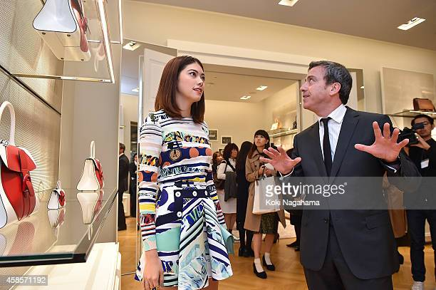 Model Hikari Mori and Delvaux CEO Marco attend the Delvaux Red Moon Party at Delvaux Omotesando on November 7 2014 in Tokyo Japan