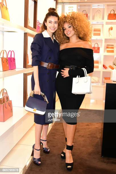 Model Hikari Mori and Jillian Hervey of Lion Babe attend the cocktail party at Michael Kors Omotesando Store during 'Michael Kors The Walk...