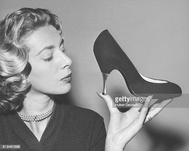 A model holds an aluminiumheeled stiletto shoe made with black suede at a show of Dolcis' autumn collection Mayfair 1956