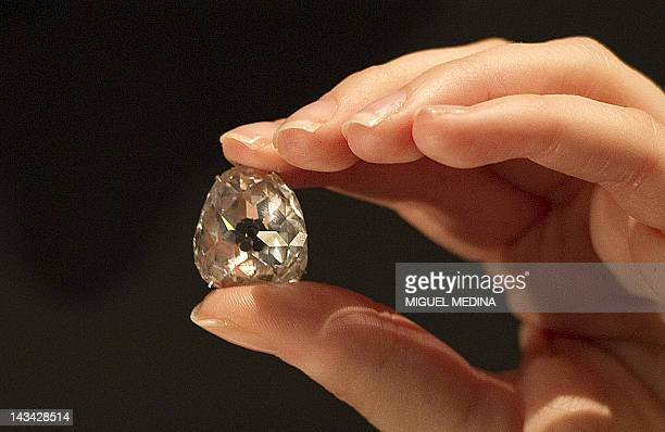 A model holds The Beau Sancy a 3498 carat diamond that has been passed down through four European royal families at the Sotheby's auction house in...