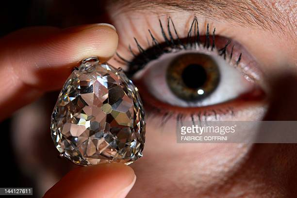 A model holds the Beau Sancy diamond during a Sotheby's auction press preview on May 10 2012 in Geneva The 35carat pearshaped diamond Marie de Medici...