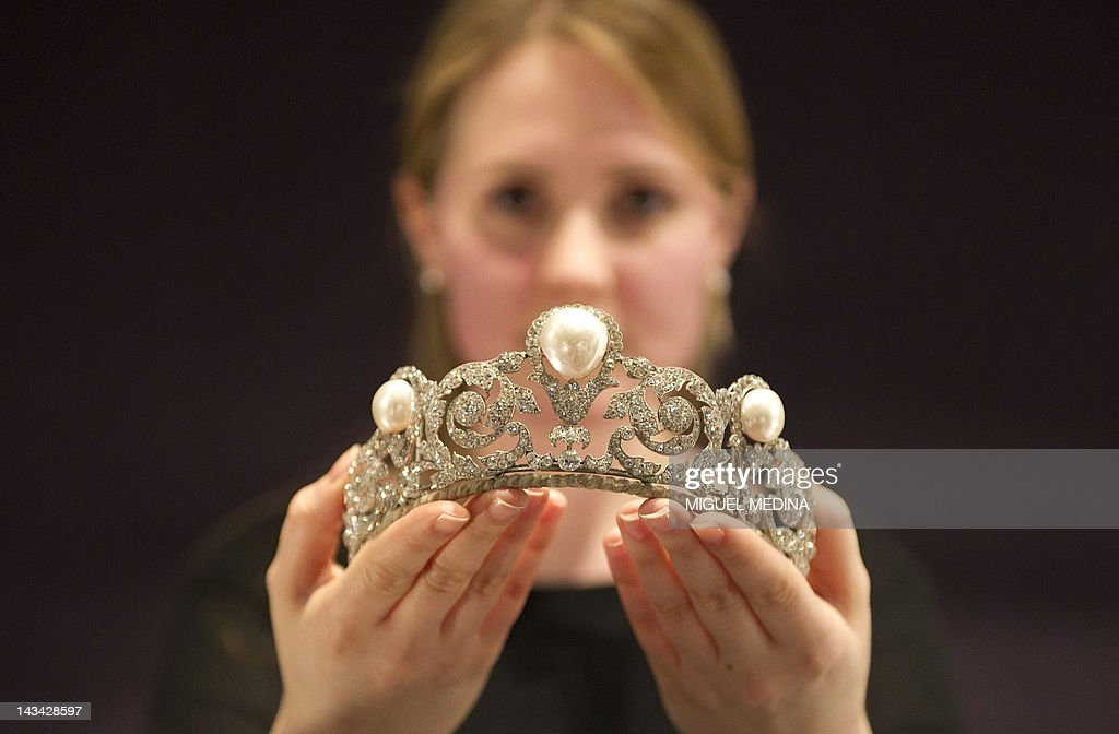 A model holds The Murat Tiara, a pearl and diamond jewel created in 1920 by Joseph Chaumet for the marriage of Prince Alexandre Murat to Yvonne Gillois, at the Sotheby's auction house in London on April 26, 2012, before it goes on sale in Geneva next month. The Tiara 1.5 to 2.5 million USD when it goes on sale during Sotheby's Magnificant and Noble Jewels sale on May 14-15.