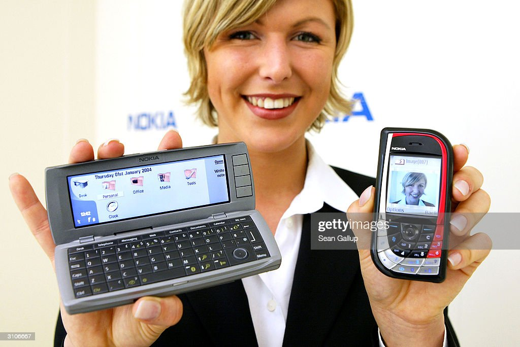 A model holds the new Nokia 7610 mobile phone and the