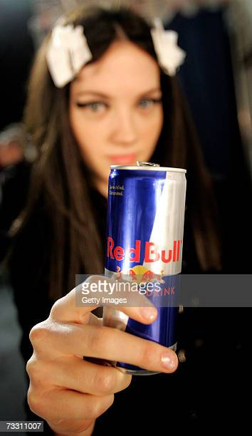 A model holds up a can of Red Bull backstage at London Fashion Week in the BFC tent on February 13 2007 in London England