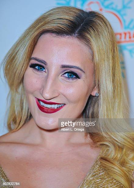 Model Holly Wolf arrives for Babes In Toyland And BenchWarmer Charity Toy Drive held at Avalon on December 9 2015 in Hollywood California