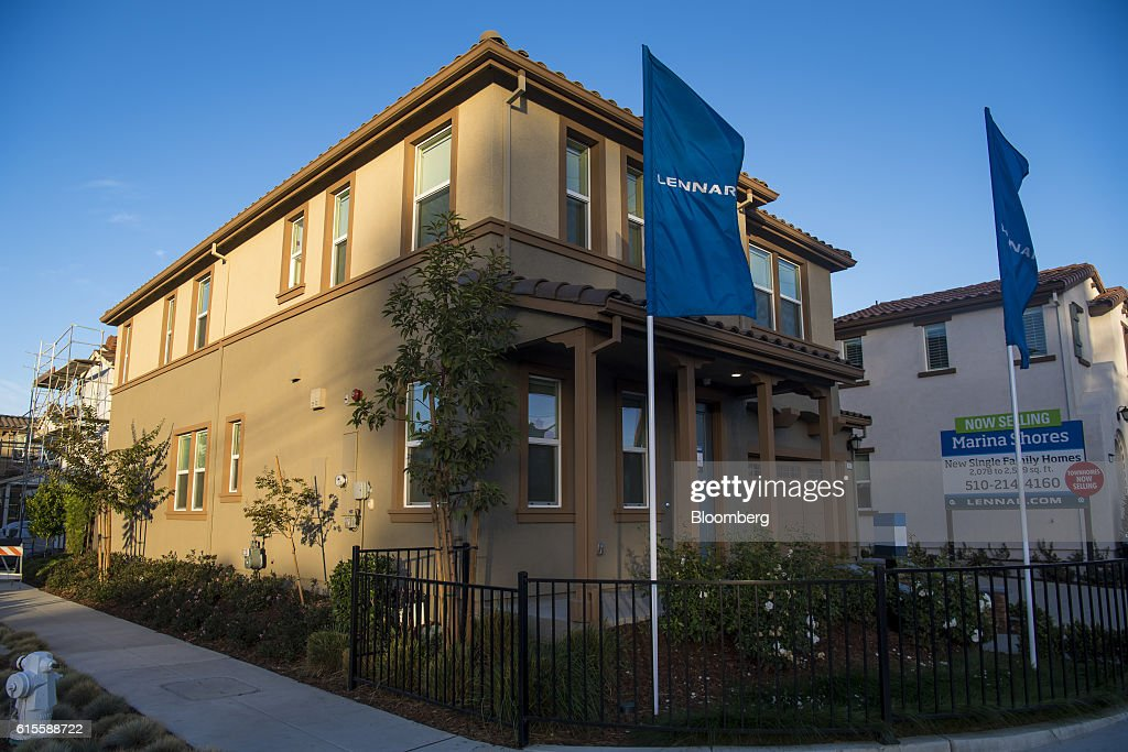 A model home at the Lennar Corp. Marina Shores development stands in Alameda, California, U.S., on Monday, Oct. 17, 2016. As iPhone sales growth slows, Apple Inc. is teaming up with a handful of builders to inch its way into the market for Internet-connected home furnishings, a nascent field that has attracted rivals like Alphabet Inc.s Google and Amazon.com. Photographer: David Paul Morris/Bloomberg via Getty Images