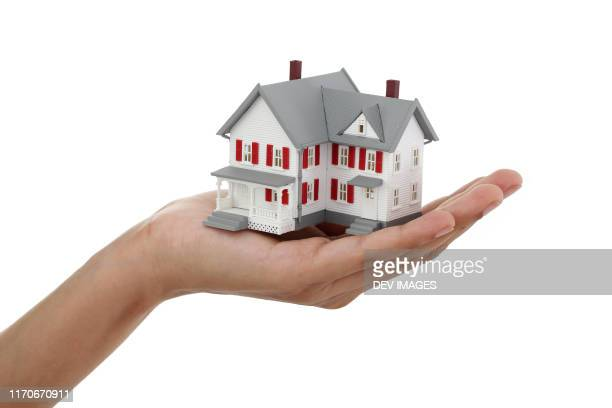 model house against white background - dollhouse stock pictures, royalty-free photos & images