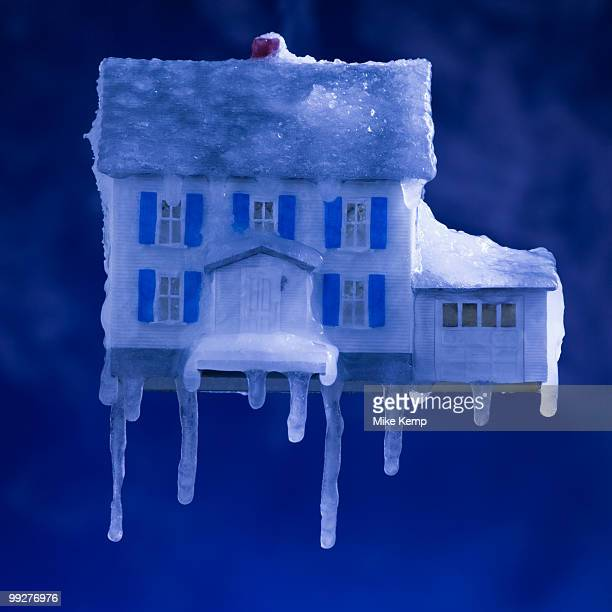 Model house covered in ice