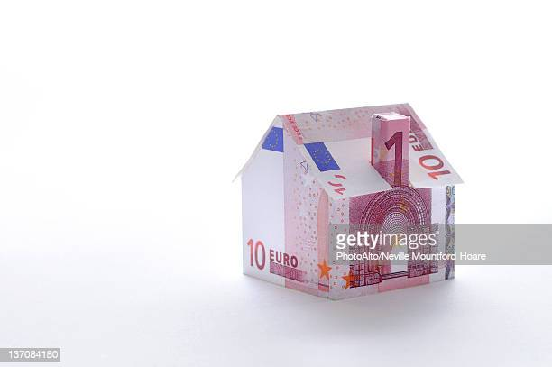 Model house folded with euro banknote