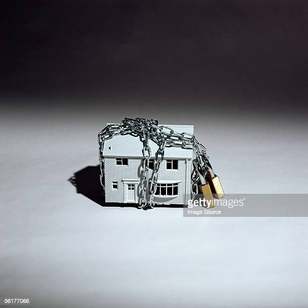 model house in chains - trapped stock pictures, royalty-free photos & images
