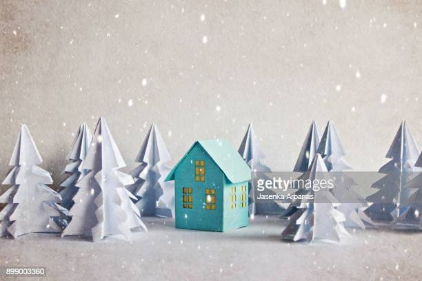 a model house in forest with snow - holiday card stock photos and pictures