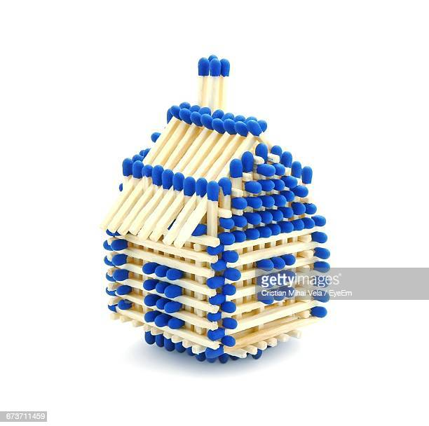 Model House Of Matchsticks On White Background