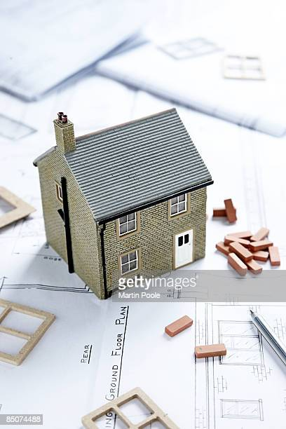 model house on blueprints of home