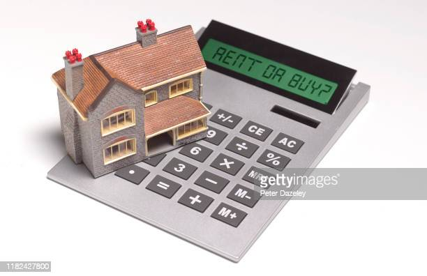 model house on calculator - buying stock pictures, royalty-free photos & images