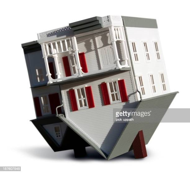 A model house that is turned upside down