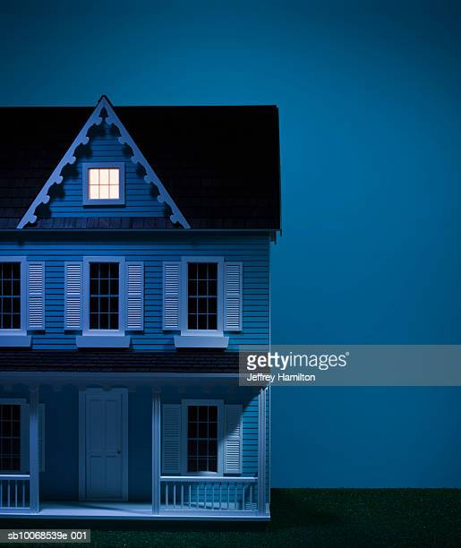 Model house with attic illuminated, close-up