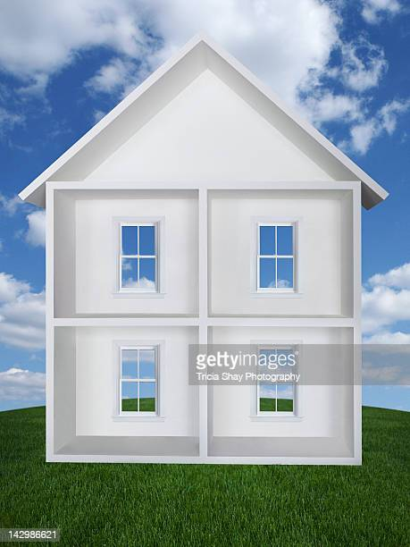 model house with windows, blue sky and grass - ドールハウス ストックフォトと画像
