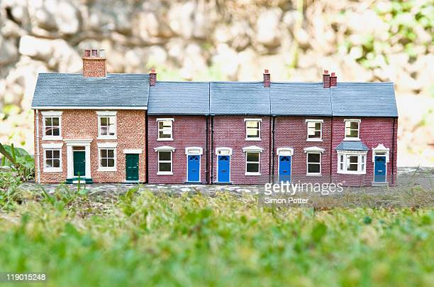 Model houses on stone outdoors