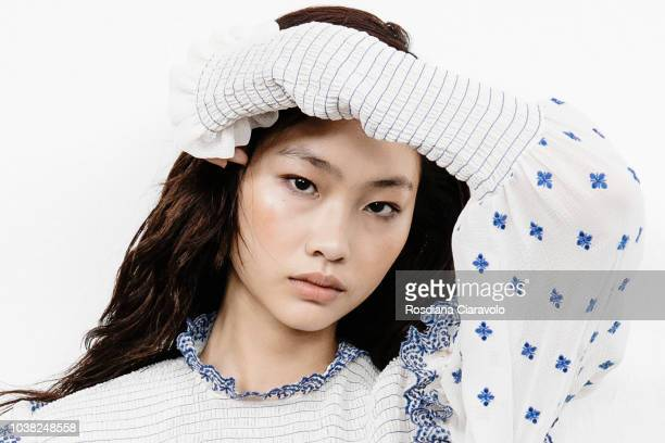 Model Hoyeon Jung is seen backstage ahead of the Philosophy Di Lorenzo Serafini show during Milan Fashion Week Spring/Summer 2019 on September 22...