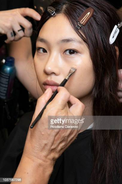 Model Hoyeon Jung is seen backstage ahead of the Sportmax show during Milan Fashion Week Spring/Summer 2019 on September 21 2018 in Milan Italy