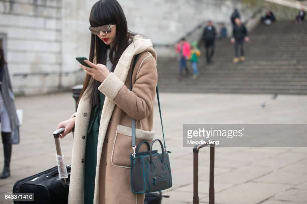 Model Huan Zhou wears Area NYC reflective sunglasses and a Celine bag after the Osman show at ICA on day 4 of the London Fashion Week February 2017...