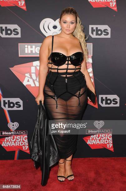 Model Hunter McGrady arrives at the 2017 iHeartRadio Music Awards at The Forum on March 5, 2017 in Inglewood, California.