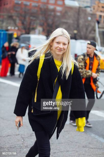 Model Hunter Schafer wears black and yellow on February 9 2018 in New York City