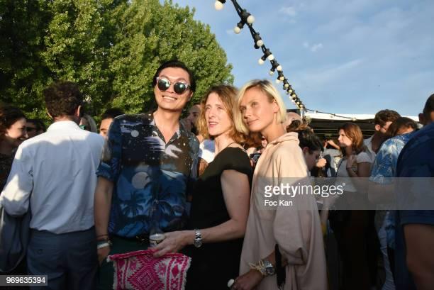 Model Iguana Butane a guest and PR /designer Axel Huyhn attend 'Ibiza Boheme' Launch Party By BHV Marais on BHV Marais Boat on June 7 2018 in Paris...
