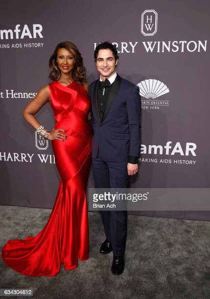 Model Iman and designer Zac Posen attend the amfAR New York Gala, where Harry Winston is a Presenting Sponsor, at Cipriani Wall Street on February 8,...