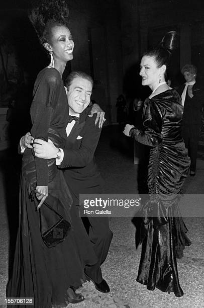 Model Iman and designers Raphael Lopez Sanchez and Paloma Picasso attend Yves St Laurent Retrospective Dinner Dance on December 5 1983 at the...