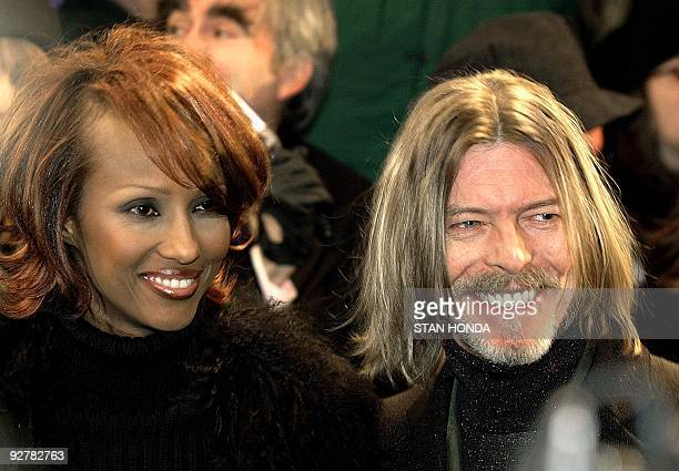 Model Iman and her husband singer David Bowie arrive at the New York premiere of Hannibal at the Ziegfeld Theatre 05 February 2001 AFP PHOTO/ Stan...