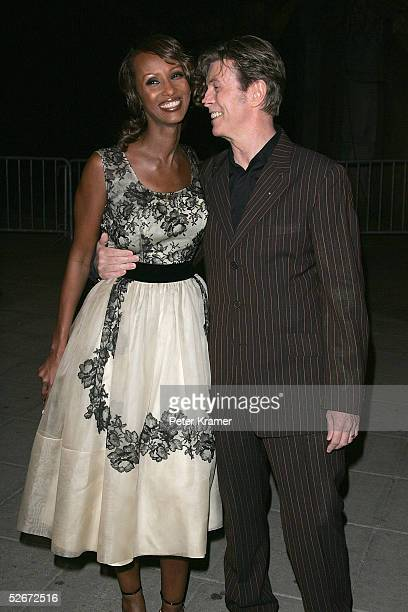 Model Iman and musician David Bowie arrive at the Vanity Fair party for the Tribeca Film Festival April 20 2005 in New York City