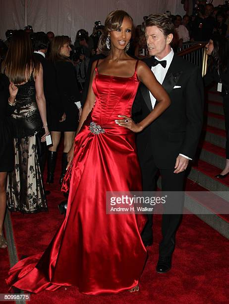 Model Iman and musician David Bowie arrives to the Metropolitan Museum of Art Costume Institute Gala Superheroes Fashion and Fantasy held at the...