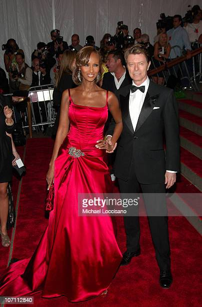 Model Iman and musician David Bowie attend the Metropolitan Museum of Art Costume Institute Gala 'Superheroes Fashion And Fantasy' at the...
