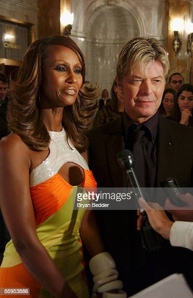 Model Iman and musician David Bowie talk to reporters at the party for Iman's new book 'The Beauty of Color' hosted by Naomi Campbell October 18 2005...