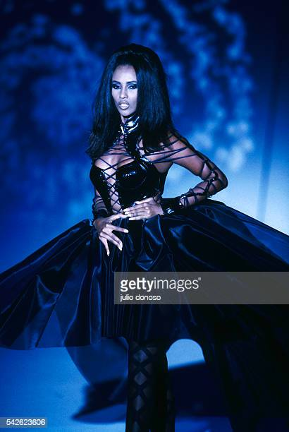 Model Iman wears readytowear women's fashions at a 1990 springsummer fashion show for French fashion house Thierry Mugler in Paris Her outfit...