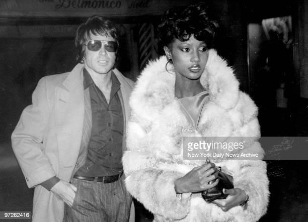 Model Iman with Warren Beatty at Regines disco