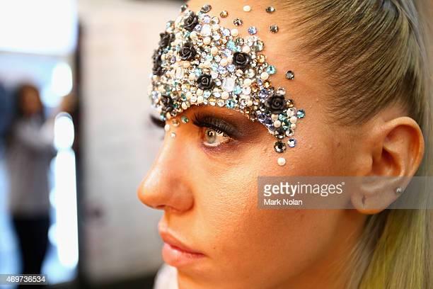 Model Imogen Anthony prepares backstage ahead of the Bondi Bather show at MercedesBenz Fashion Week Australia 2015 at Carriageworks on April 15 2015...