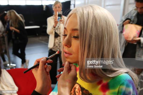 Model Imogen Anthony prepares backstage ahead of the Swim and Activewear Collective show during New Zealand Fashion Week 2018 at Viaduct Events...