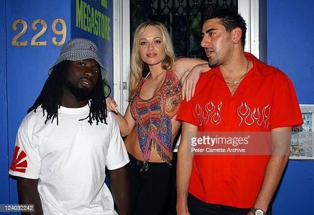 Model Imogen Bailey with members of the UK band Superfly at the launch of her latest calendar on November 28 2002 in Sydney Australia