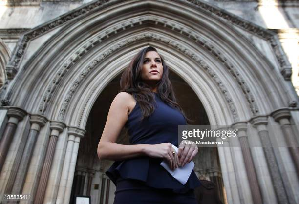 Model Imogen Thomas poses outside The High Court on December 15 2011 in London England Miss Thomas is continuing her legal battle over a relationship...