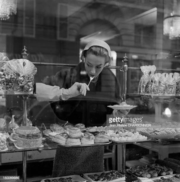 Model in a cake shop during a photo shoot 1960 in Paris France