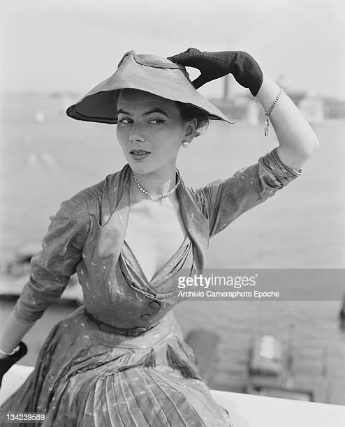A model in a Christian Dior outfit near the Piazza San Marco Venice 3rd June 1951 In the background is the island of San Giorgio Maggiore